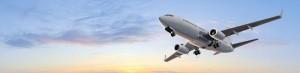 Modern Passenger airplane flight in sunset panorama